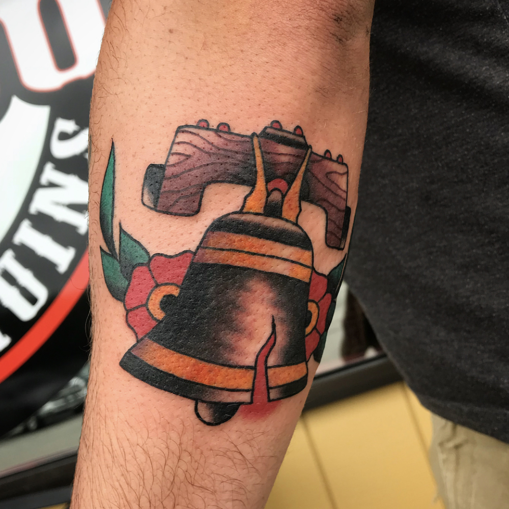 Traditional Liberty bell tattoo