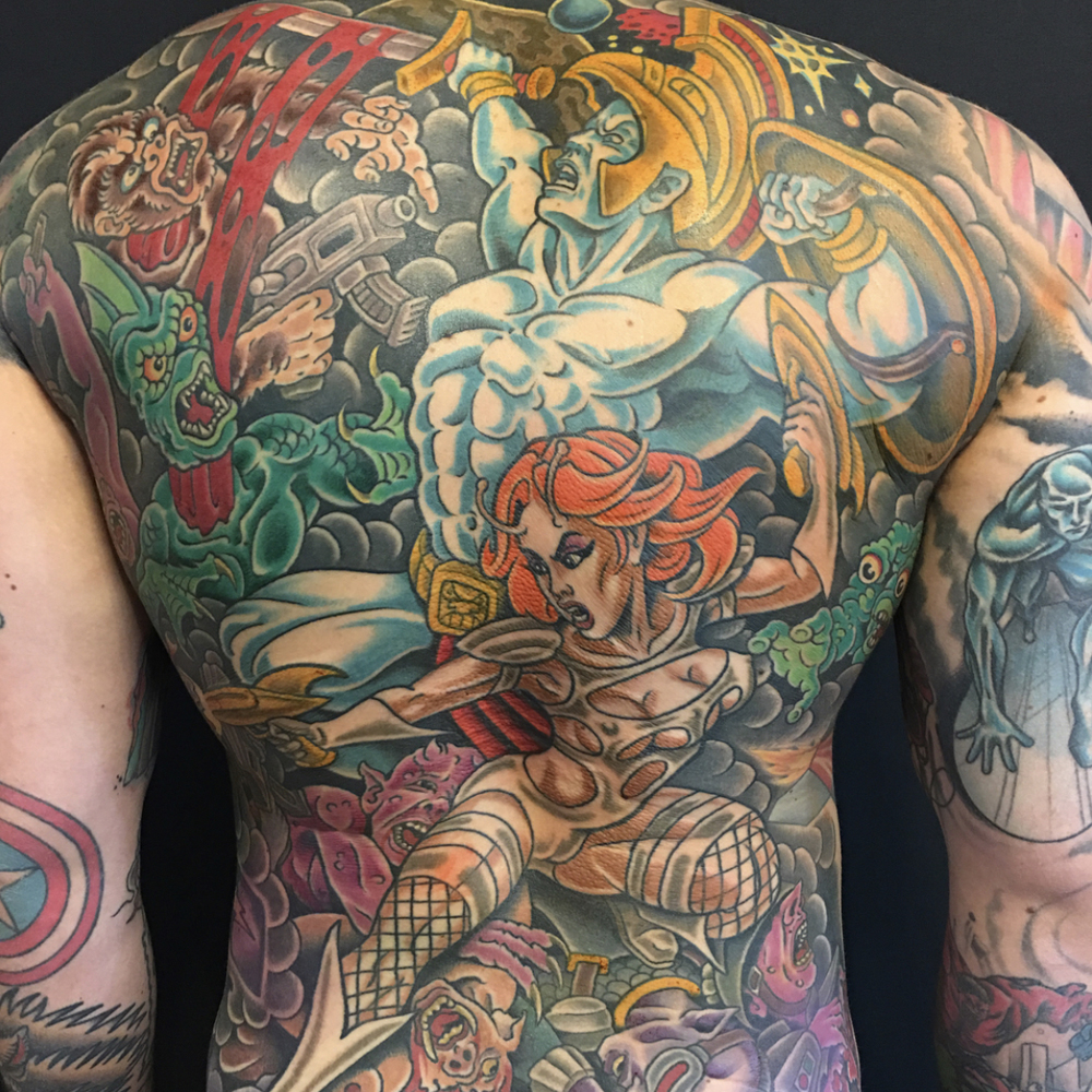 Traditional warrior back piece tattoo